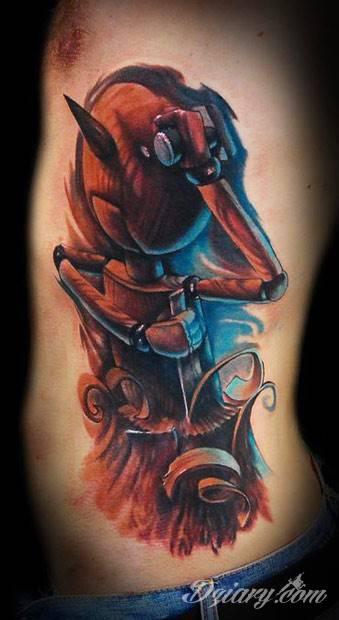 Tatuaż Drewniana kukiełka strugająca.